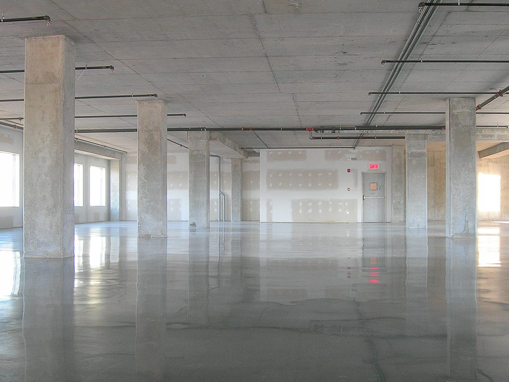 plancher béton poli industriel / industral slab floor polishing